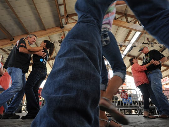 People dance at a Louisiana festival in May.