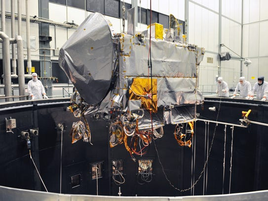 The OSIRIS-REx spacecraft being lifted into the thermal