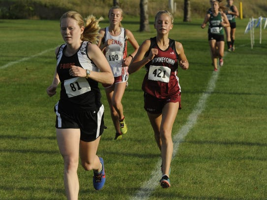 Winneconne's Morgan Fenrich (421) keeps her pace during