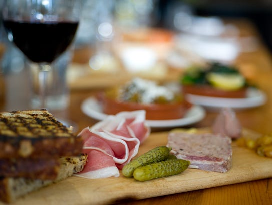 Charcuterie plates are among snacks served at The Kitchen.