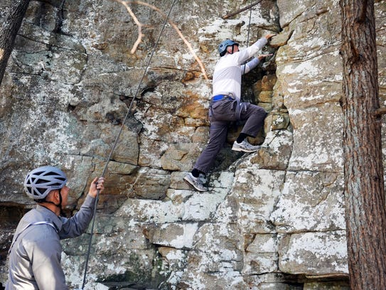 News Sentinel reporter Steve Ahillen, right, is belayed