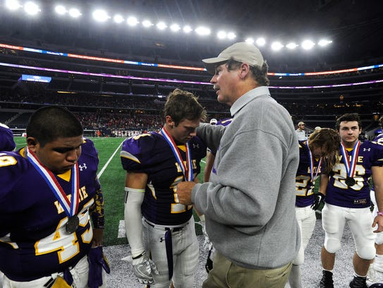 Wylie head coach Hugh Sandifer consoles safety Cameron