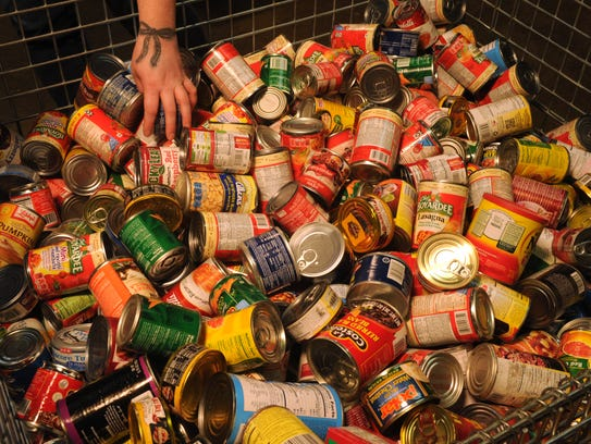 Volunteers sort cans at the Food Bank of West Central