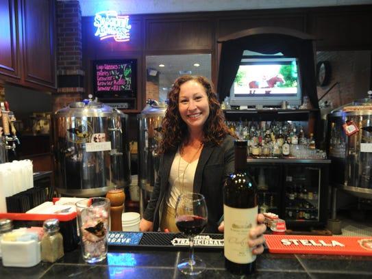 Amanda O'Connor stands behind the bar at Cypress Street