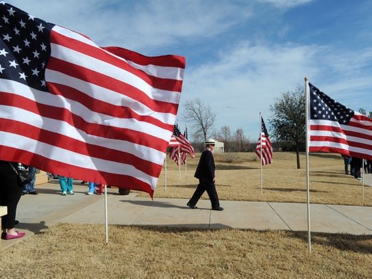 Mourners arrive at the service for Vietnam veteran