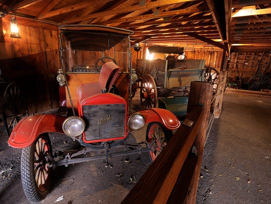 Old cars and buggies sit in the wagon barn of the Buffalo