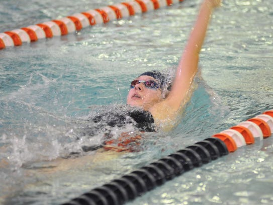 Sari Conner faces a tough opponent in Ontario's Becca Gregg in the 100 and 200 freestyle.