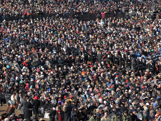 A sea of spectators listen as Obama delivers his inaugural
