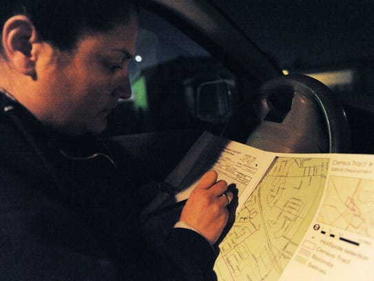Volunteer Daniela Mejia checks a census tract map during a 2017 Point-In-Time Homeless Count and Survey in California.