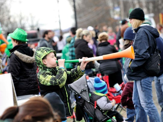Jason Stone a blows horn during the 2016 St. Patrick's