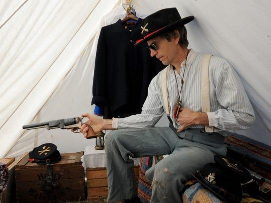 Barry Schrock, a Union artilleryman, shows his Colt