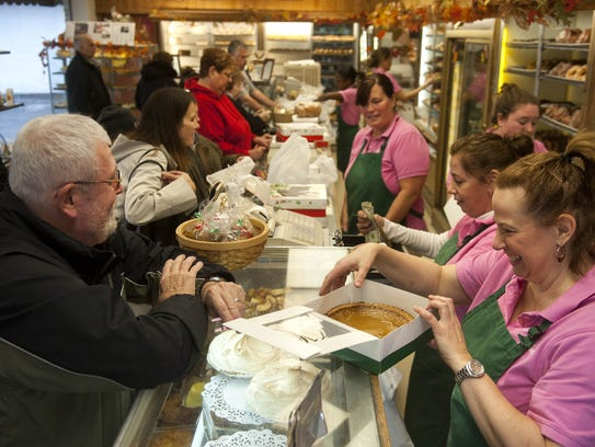 Customers line up at McMillan's in Westmont in 2013 for cakes, doughnuts and other goodies. Cream doughnuts are a top seller at the bakery, which also offers a Cream Doughnut Cake for Valentine's Day and all year long.