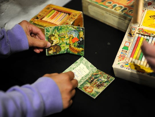 Sujata Shahane sets up a display of Tiny Animal Storybooks