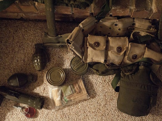 U.S. military gear, ammunition and canned rations issued
