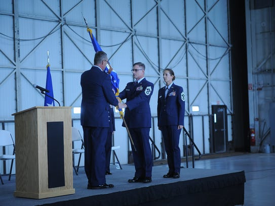 Chief Master Sgt. Michael Clauson and Col. Nathan Alholinna