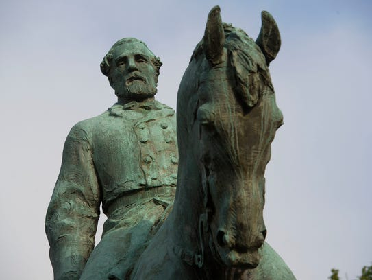 The statue of Robert E. Lee stands in Emancipation
