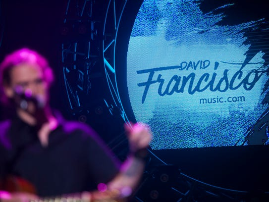 Musician David Francisco performs on stage while opening