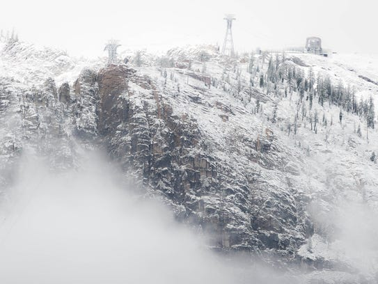 The first snow of the season is seen Thursday, Sept.