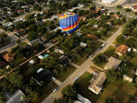 A balloon flies over a neighborhood near Buffalo Gap