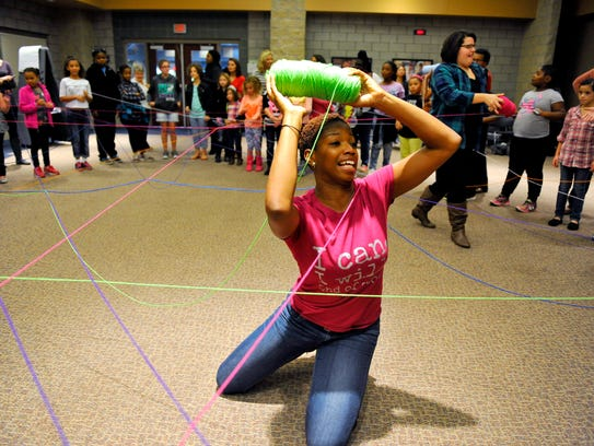 A facilitator for Her Space helps with a self-esteem