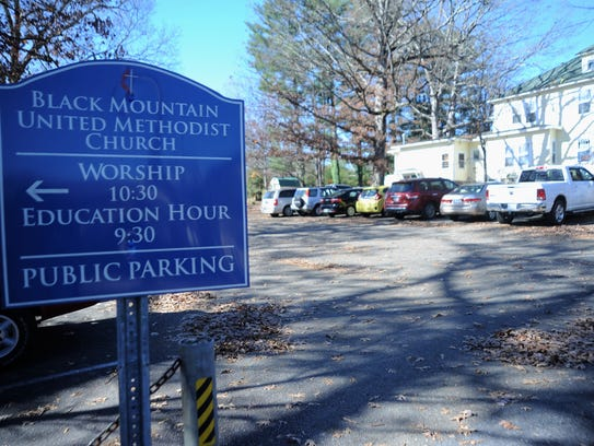 A sign at Black Mountain United Methodist Church on Church Street welcomes public parking.