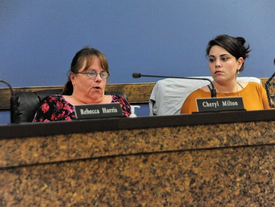 Zoning board of adjustment chair Cheryl Milton, left,