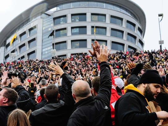 Iowa Hawkeyes fans wave to the Iowa Children's Hospital