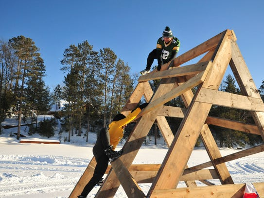 Competitors complete an obstacle during the Arctic