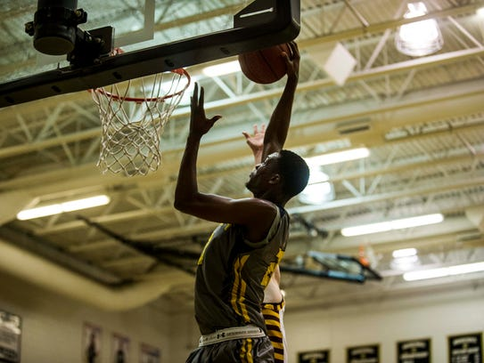 Lehigh Acres High School senior Mo Goin dunks against