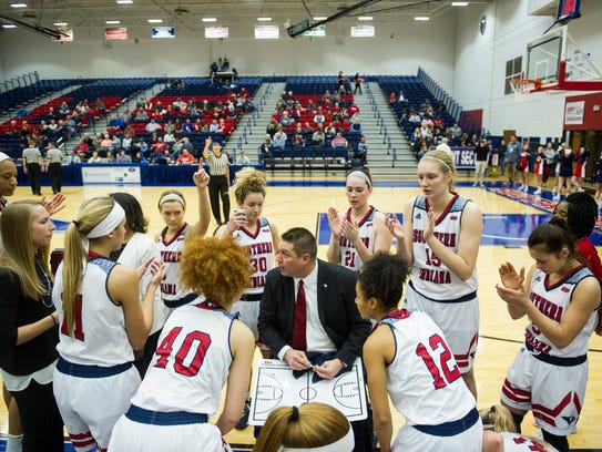 USI Head Coach Rick Stein talks with his team at the