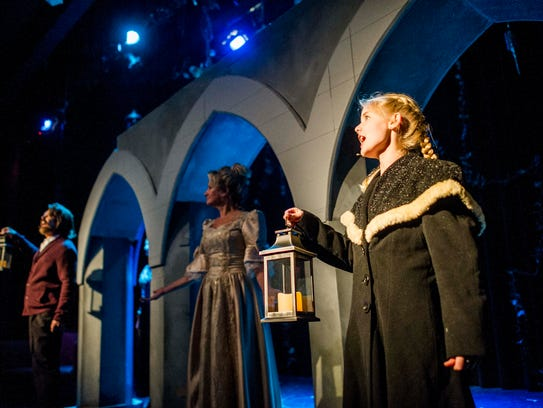 Carly Barnes, right, acts as Mary Lennox during a dress