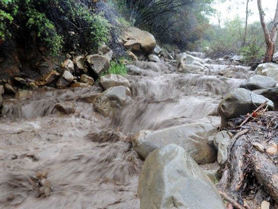 Water was raging down Pratt Trail in Ojai as the storm