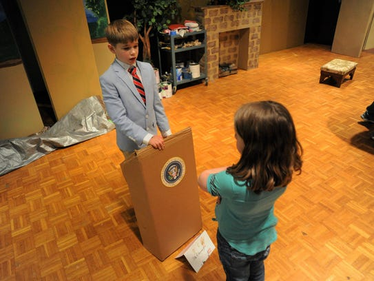 A student from Jaime Goodwin's class at Black Mountain Primary does a brief presentation on the life of John F. Kennedy.