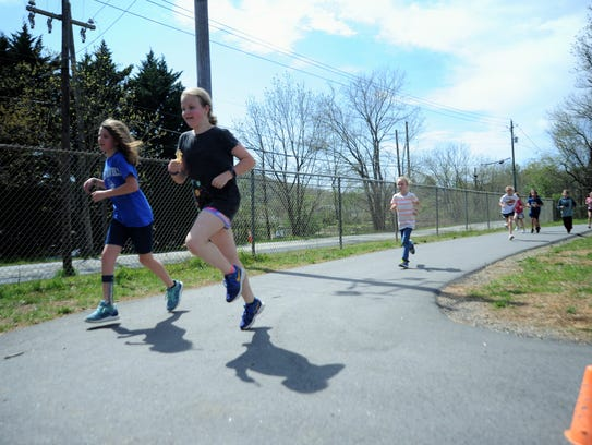 ​Ginger Riddle, front right, practices for the upcoming War Pony 5K, which will benefit her school, W.D. Williams Elementary.        ​