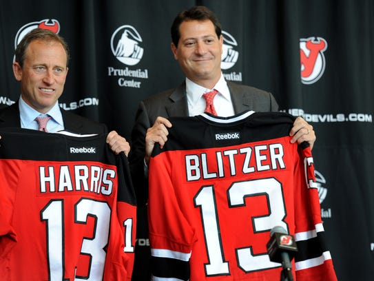 New Devils owners Joshua Harris and David Blitzer during
