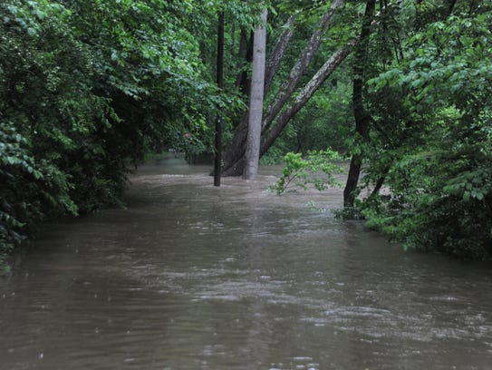The Flat Creek Greenway is submerged after heavy rains