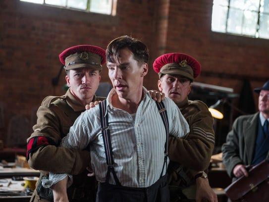 Benedict Cumberbatch, center, plays Alan Turing, who