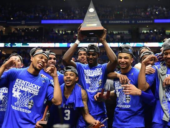 Kentucky Wildcats players celebrate their SEC tournament