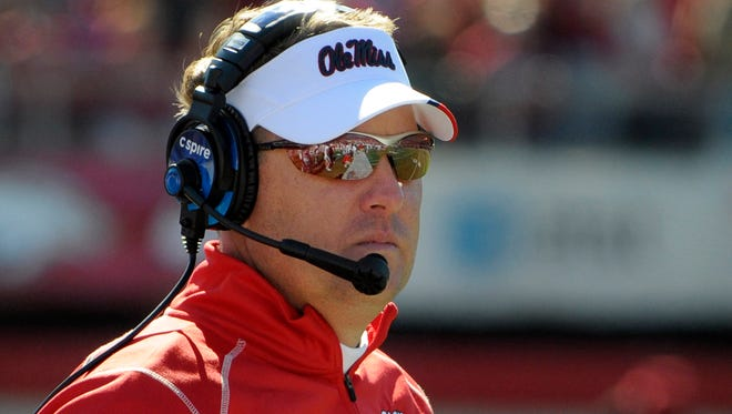 Ole Miss coach Hugh Freeze watches during the first half of an NCAA college football game against Arkansas in Little Rock, Ark., Saturday, Oct. 27, 2012. Mississippi defeated Arkansas 30-27. (AP Photo/David Quinn)