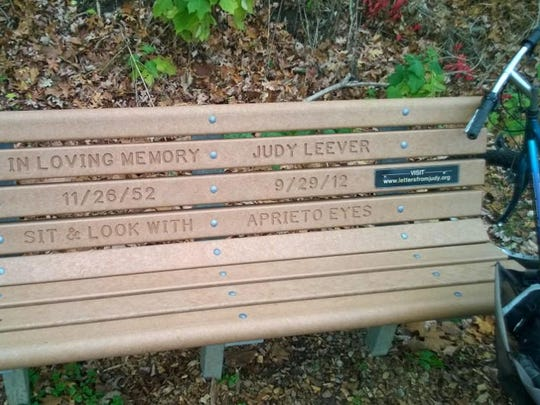 Racist graffiti on the Loveland Bike Trail was placed right in front of a bench placed in memory of Judy Leever.