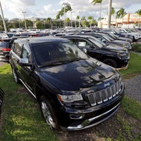 2015 Jeep Grand Cherokees appear on display at a Fiat Chrysler dealership in Doral, Fla.