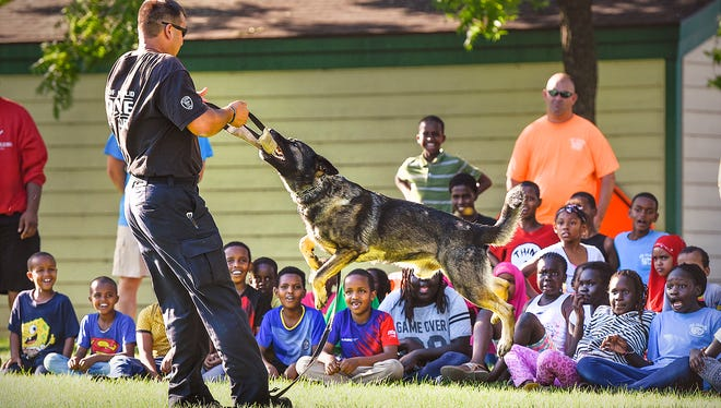 St. Cloud police officer Brian Cameron and his partner Ramo put on a demonstration of Ramo's abilities Tuesday, July 19, at the Southside Boys & Girls Club. Members of the department's Police Activity League (PAL) do activities with the club members ending the evening with a cookout.