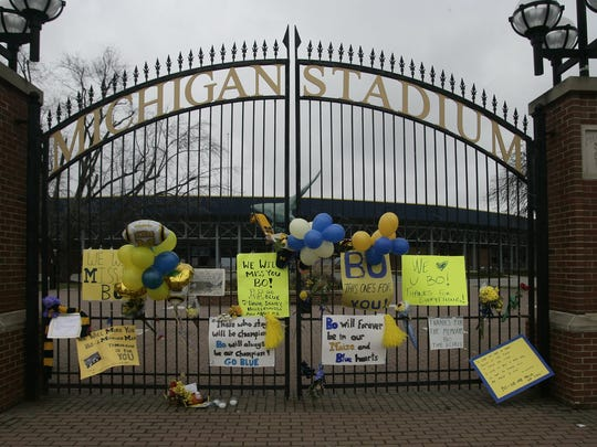 The gates to Michigan Stadium are decorated with tributes to former Michigan football coach Bo Schembechler in 2006.