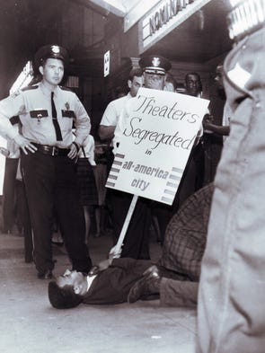 Avon Rollins protests on the sidewalk at the Tennessee