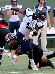 Wichita Falls High's Jacob Weaver grabs a hold of Arlington