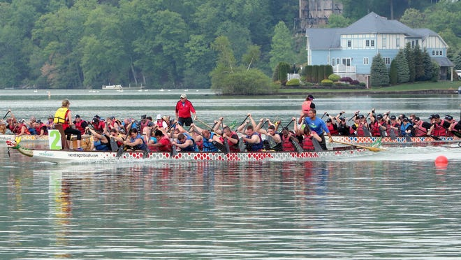 Competitors race across Lake Mohawk during the dragon boat races in Sparta, NJ, on Sunday, May 17, 2015.