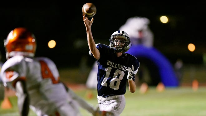 West York quarterback Corey Wise throws a touchdown pass against Central York in the second half of a YAIAA football game Friday, Sept. 1, 2017, at West York. Central York defeated West York 28-13 in the first high school football game of the YAIAA season.