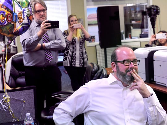 KTXS television anchor George Levesque smiles as he watches the Memory Men sing to him on his last day at the station Thursday. Levesque is leaving KTXS after more than 18 years to work at the Paramount Theatre.