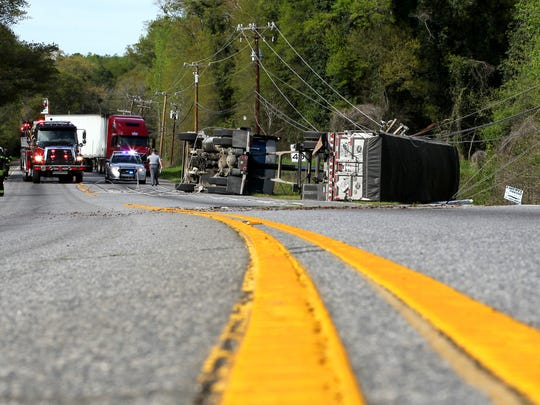 Emergency personnel work at the scene after an overturned tractor-trailer on U.S. 29 North near Plantation Road in Anderson on Friday.