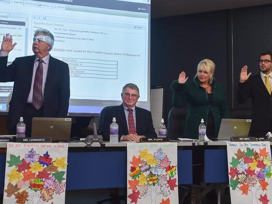 Bill Lennartz, left, Joan Smith, center, and Alexander